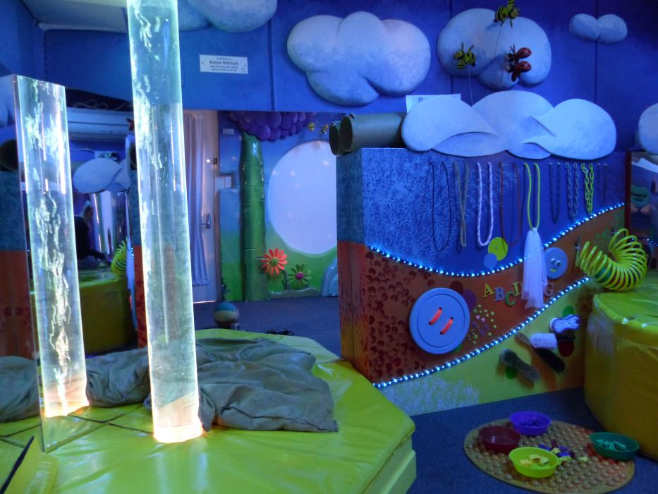 Multi-sensory room with lights, textured surfaces and bubble tube